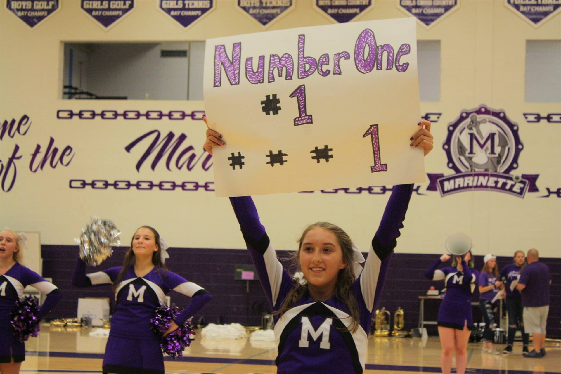 "Cheerleader holding ""Number 1"" Sign"