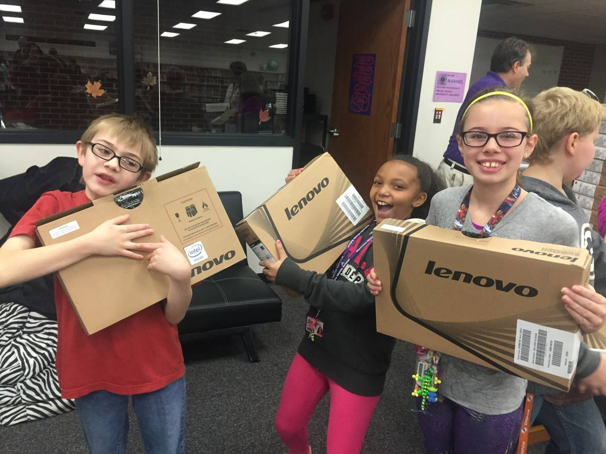 Children holding Lenovo products