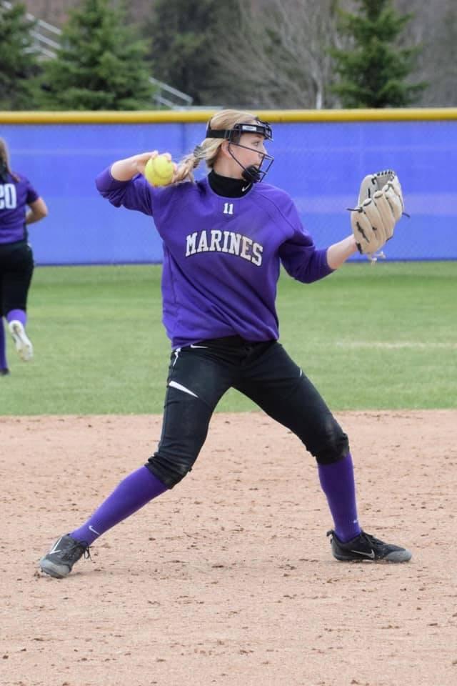 Girl throwing softball